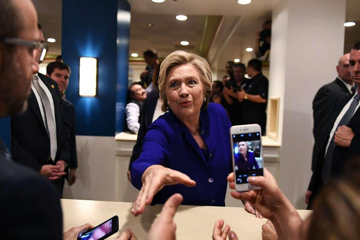 US Democratic presidential nominee Hillary Clinton greets empolyees of the Mirage - Las Vegas Hotel & Casino, in Las Vegas, Nevada, on November 2, 2016. / AFP PHOTO / Jewel SAMADJEWEL SAMAD/AFP/Getty Images