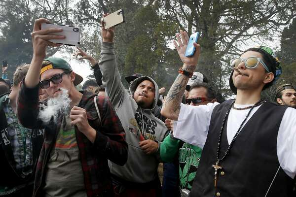 Everyone in the crowd lit up and toolk a selfie at four twenty. The annual four twenty celebration of marijuana smoking was attended by thousands near Hippie Hill in Golden Gate Park.