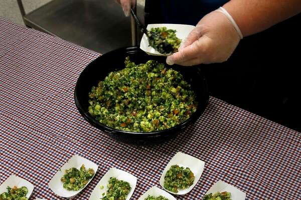Oakland Unified School District executive director for nutrition services, Jennifer LeBarre prepares the samples of tabbouleh salad for a taste test by students at Glenview Elementary school in support the good food purchasing program in Oakland, California as seen on Wednesday November 2, 2016.