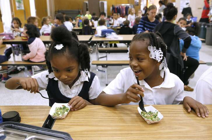 Glenview Elementary first graders Miracle Tarrant, (left) and Mi' Yani Moore participate in the tabbouleh salad taste test given by the Oakland Unified School District  in support of the Good Food Purchasing Program in Oakland, California as seen on Wednesday November 2, 2016. The two said they liked the salad.