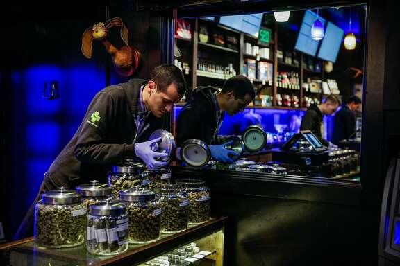 Budtender Alejandro Garcias smells marijuana at cannabis dispensary The Green Cross, in San Francisco, California, on Tuesday, Nov. 1, 2016.