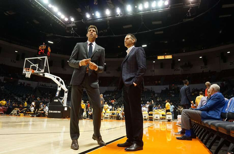 Warriors general manager Bob Myers hangs out on the court during a game against the Lakers at the Valley View Casino Center in San Diego. Photo: Sandy Huffaker, Special To The Chronicle