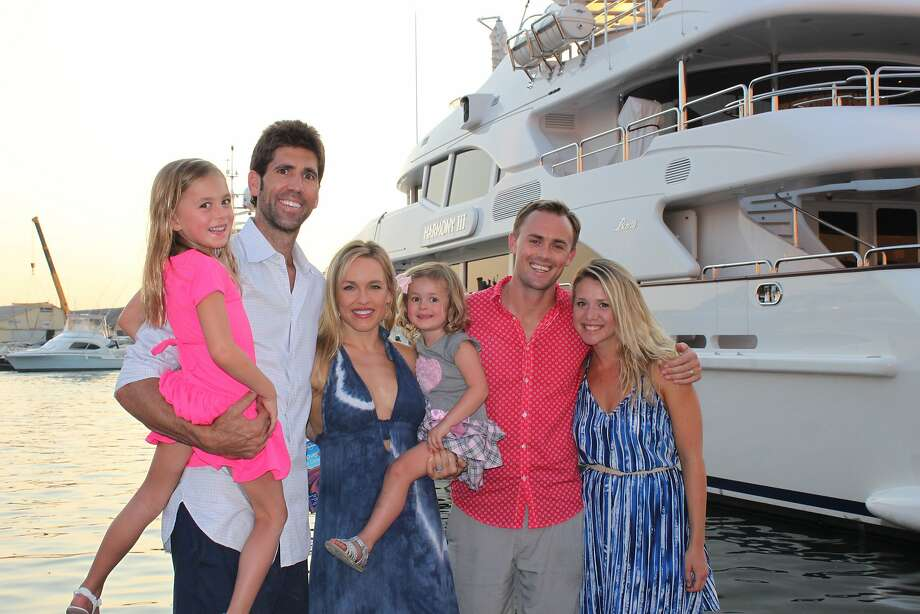 Scott Dinsmore (second from right) poses with his wife, Chelsea, sister, Kristen, brother-in-law, Bob Myers, and nieces Annabelle and Kayla in France in August 2015. Photo: Courtesy Kristen Myers