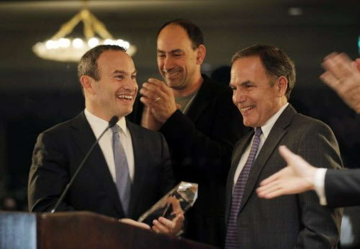 Evan Marwell receives the award from Chronicle Editor John Diaz at the San Francisco Chronicle's ceremony for the Visionary of the Year Award at the Fairmont Hotel in San Francisco , Calif., on Tuesday, March 31, 2015.