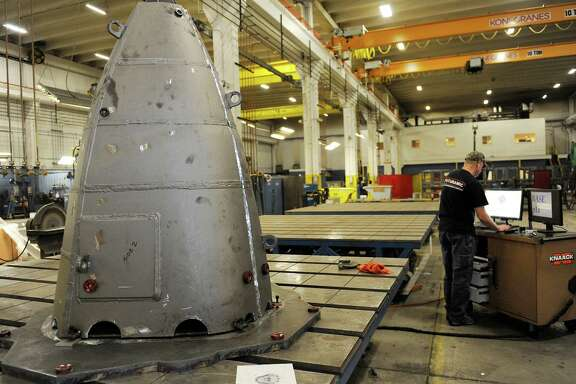 A worker does testing with the Nose Cone F35 for the NASA space program at Futuramic in Detroit, Mich., on Oct. 14. Futuramic, a former auto supplier, is now building parts for a NASA spaceship to Mars.