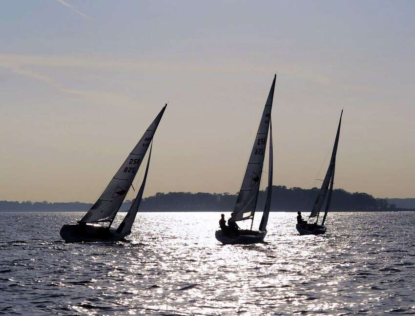 Three 18-foot sailboats that are a part of the Greenwich Country Day School sailing team's fleet, race during practice in Long Island Sound out of the Indian Harbor Yacht Club, Greenwich, Conn., Wednesday, Nov. 2, 2016.