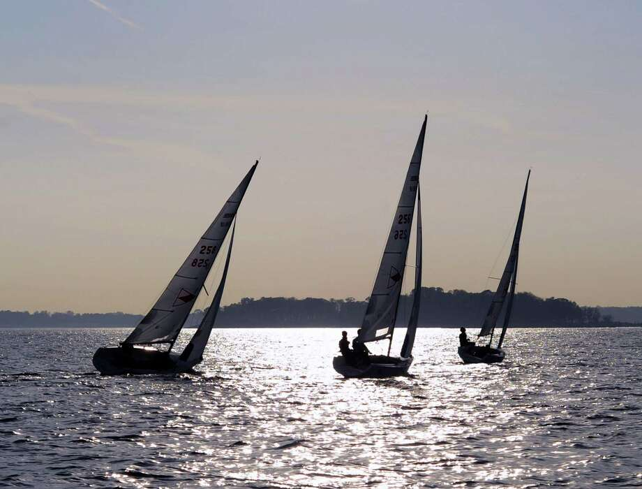 Three 18-foot sailboats that are a part of the Greenwich Country Day School sailing team's fleet, race during practice in Long Island Sound out of the Indian Harbor Yacht Club, Greenwich, Conn., Wednesday, Nov. 2, 2016. Photo: Bob Luckey Jr., Hearst Connecticut Media / Greenwich Time