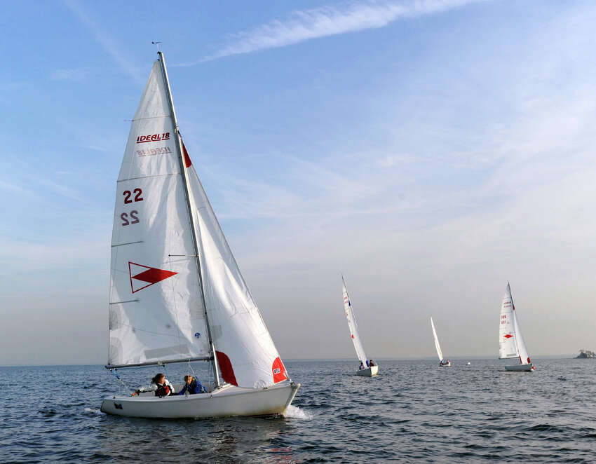 At left, Elizabeth Cutting, 12, captains an 18-foot sailboat (#22 sail) with a partner during the Greenwich Country Day School sailing team practice in Long Island Sound out of the Indian Harbor Yacht Club, Greenwich, Conn., Wednesday, Nov. 2, 2016. Cutting is in the seventh grade at the school.
