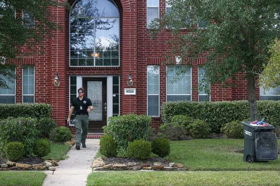 A house at 8526 Lemonmint Meadow Dr. was raided by federal authorities in the early morning, Wednesday, Nov. 2, 2016, in Houston. Six people were taken into custody,  following the return of a 32-count indictment alleging a conspiracy to steal money from bank accounts and a conspiracy involving the filing of false tax returns and aggravated identity theft. ( Jon Shapley / Houston Chronicle )