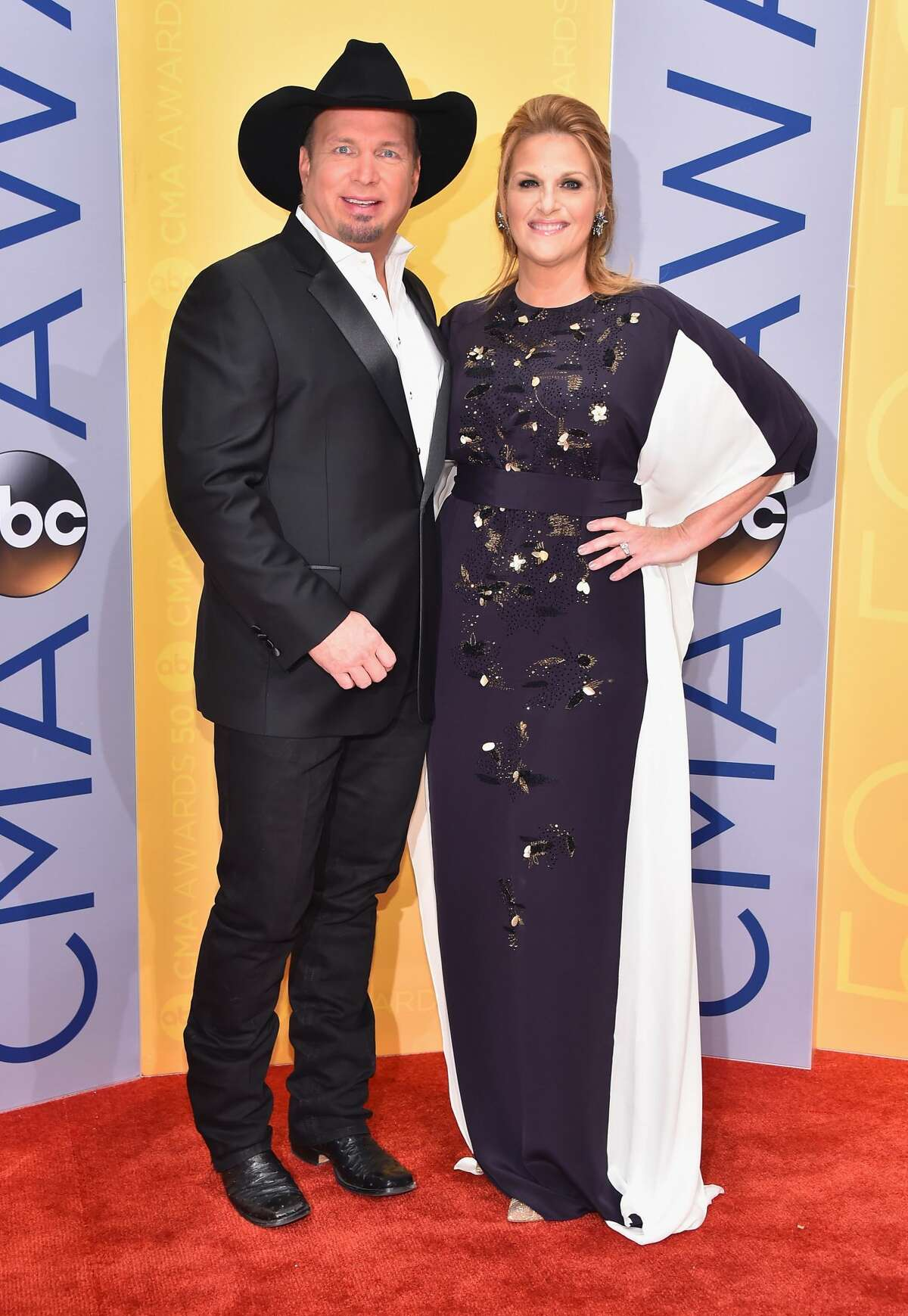 Singer-songwriters Garth Brooks and Trisha Yearwood attend the 50th annual CMA Awards at the Bridgestone Arena on November 2, 2016 in Nashville, Tennessee.