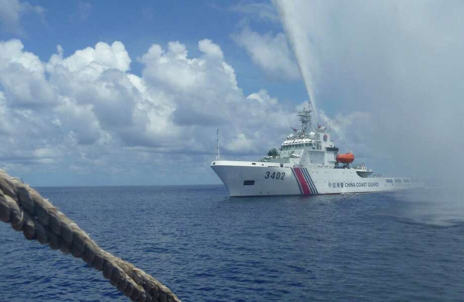 Last year, the Chinese Coast Guard fended off Filipino fishermen in the South China Sea. Now, the Filipinos may fish there unmolested thanks to a diplomatic deal with China.  Photo: Renato Etac, STR / STR