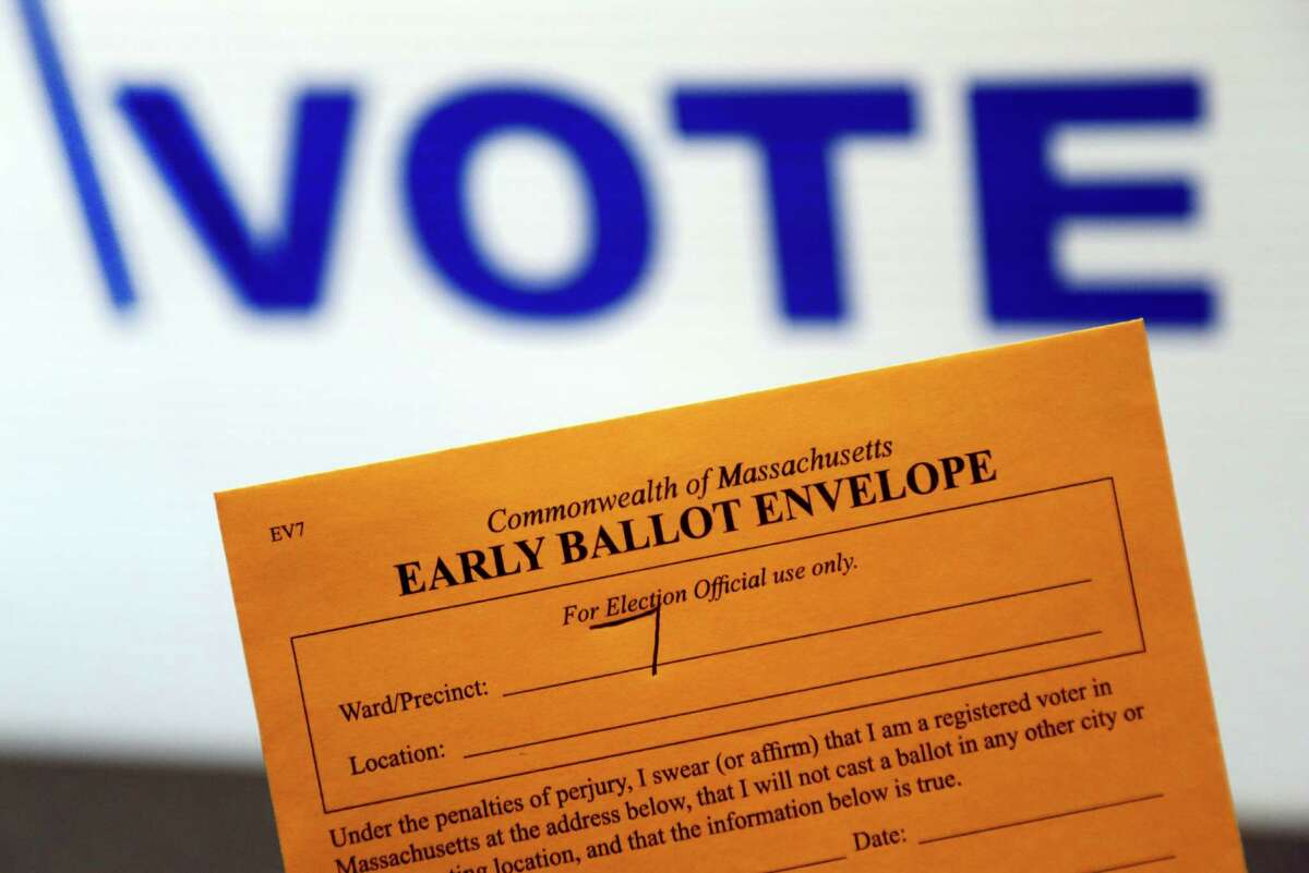 FILE - This Monday, Oct. 24, 2016, file photo, shows an early ballot envelope at town hall, in North Andover, Mass. Some small business owners want to make it easy for their staffers to vote, so theyÂ?'re giving them flex time, balloting breaks, even opening up several hours late to be sure everyone can make it to the polls. (AP Photo/Elise Amendola, File)