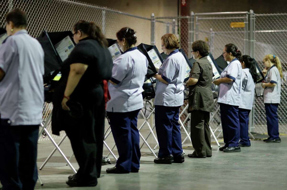 In this Oct. 26, 2016, photo, casino workers vote at an early voting site in Las Vegas. With Election Day approaching, many small businesses want to make it easy for staffers to vote. So theyÂ?'re giving them flex time, balloting breaks or are opening several hours late. (AP Photo/John Locher)