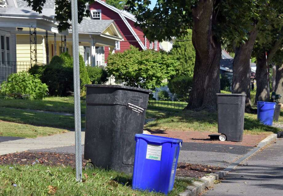 Trash cans in front of homes on Academy Road following pick up on Tuesday, Sept. 6, 2016 in Albany, N.Y.  (John Carl D'Annibale / Times Union archive) Photo: John Carl D'Annibale / 20037904A