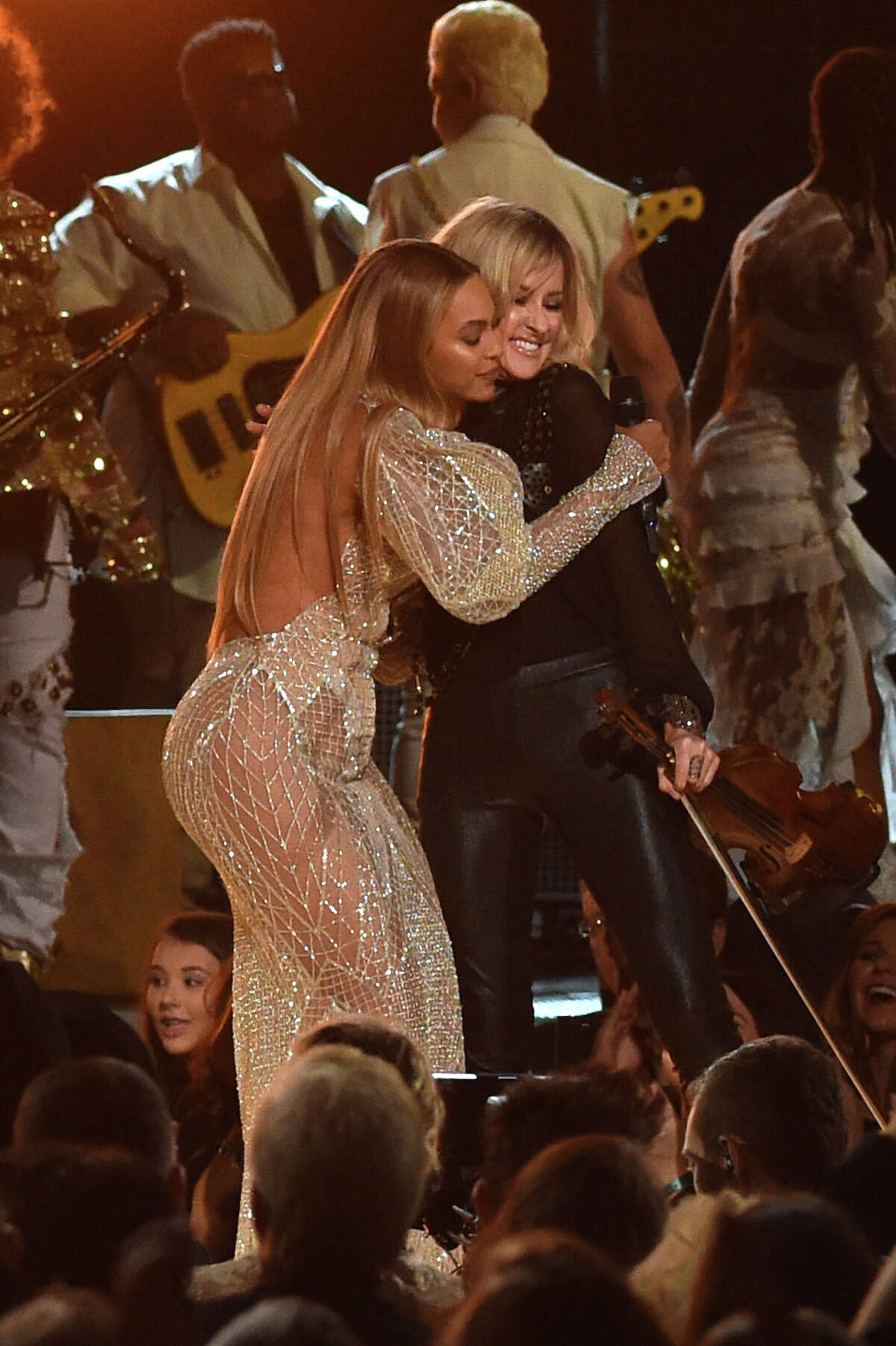 Beyonce performs onstage with Martie Maguire of Dixie Chicks at the 50th annual CMA Awards at the Bridgestone Arena in Nashville on Wednesday.