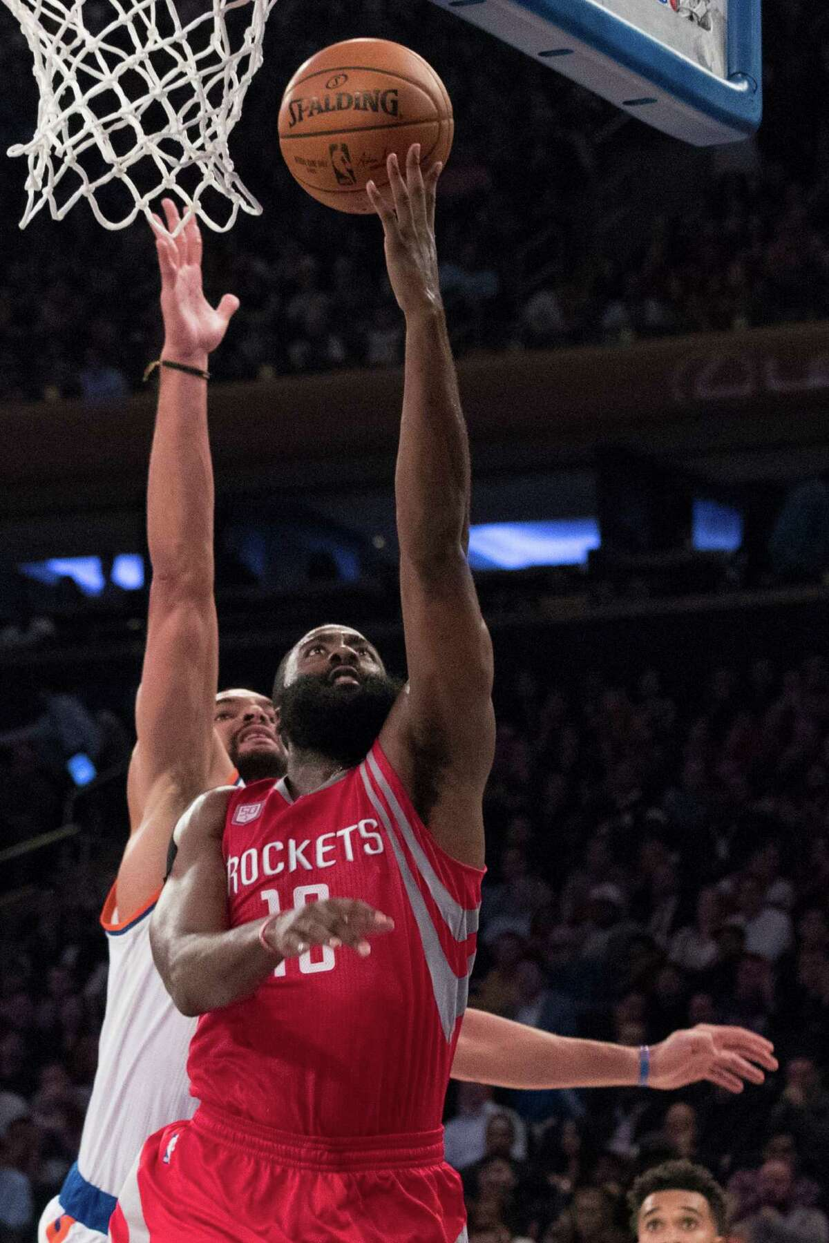 Rockets guard James Harden goes to the basket past the Knicks' Joakim Noah for two of his 30 points.