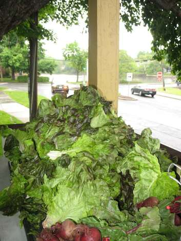 Mounds of organic-grown lettuce and beets fill a corner of the porch of the Store House Visitor's Center located next to the Bush-Holley House. The Porch hosts the Green Market on rainy days.. Photo: Anne W. Semmes / Greenwich Citizen