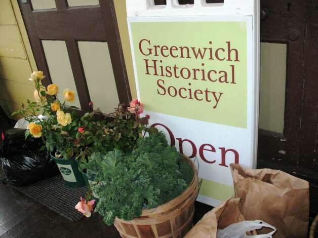 Fragrant English roses sit by organic grown kale at the Greenwich Historical Society's new Green Market, which is located on the green by the Bush-Holley House on sunny Tuesdays and Fridays. On rainy days, the market moves to the porch. Photo: Anne W. Semmes / Greenwich Citizen