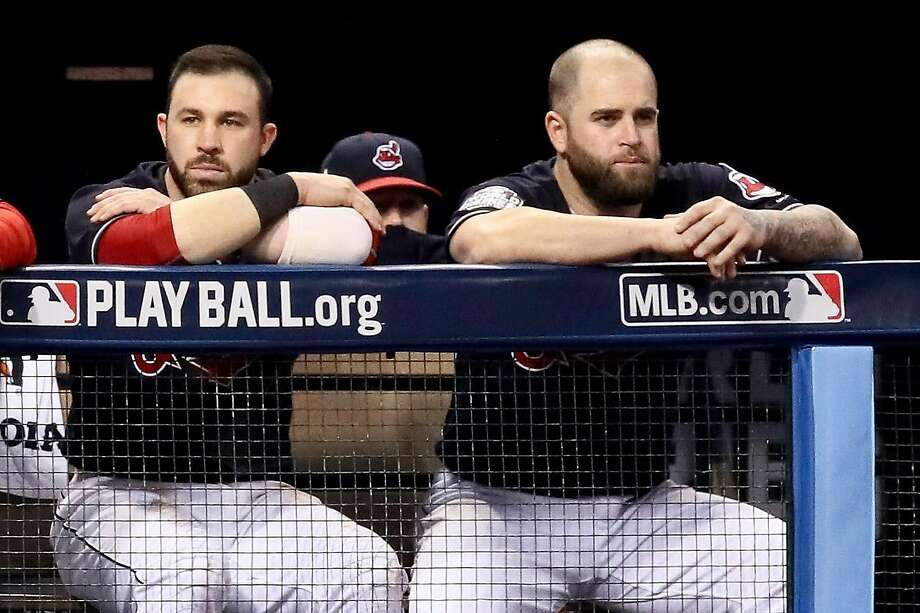 CLEVELAND, OH - NOVEMBER 02:  Jason Kipnis #22 and Mike Napoli #26 of the Cleveland Indians look on from the dugout against the Chicago Cubs in Game Seven of the 2016 World Series at Progressive Field on November 2, 2016 in Cleveland, Ohio.  (Photo by Ezra Shaw/Getty Images) Photo: Ezra Shaw, Getty Images