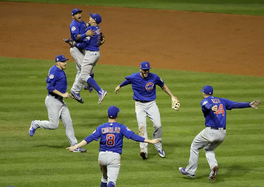 Cubs players rush to celebrate in Cleveland after Kris Bryant threw out Michael Martinez at first base for the final out of the World Series, giving Chicago an 8-7 victory in a roller- coaster, 10-inning game. Photo: Gene J. Puskar, Associated Press