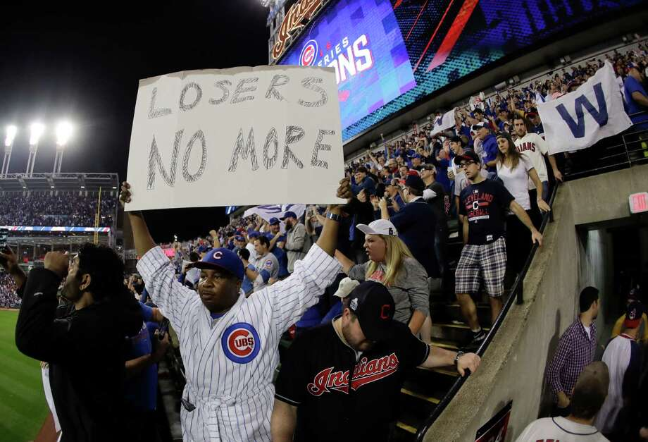 Fan react after the Chicago Cubs won Game 7 of the Major League Baseball World Series against the Cleveland Indians Thursday, Nov. 3, 2016, in Cleveland. The Cubs won 8-7 in 10 innings to win the series 4-3. (AP Photo/Charlie Riedel) Photo: Charlie Riedel, Associated Press / Copyright 2016 The Associated Press. All rights reserved.