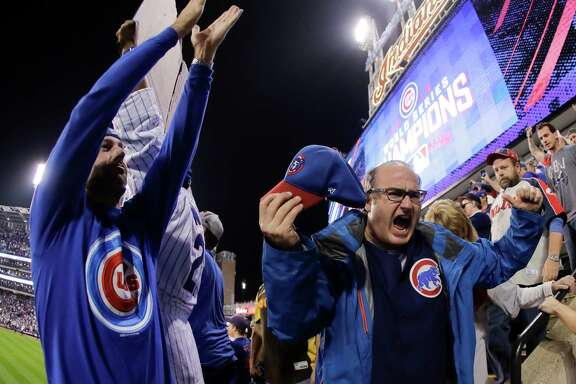 Fan react after the Chicago Cubs won Game 7 of the Major League Baseball World Series against the Cleveland Indians Thursday, Nov. 3, 2016, in Cleveland. The Cubs won 8-7 in 10 innings to win the series 4-3. (AP Photo/Charlie Riedel)