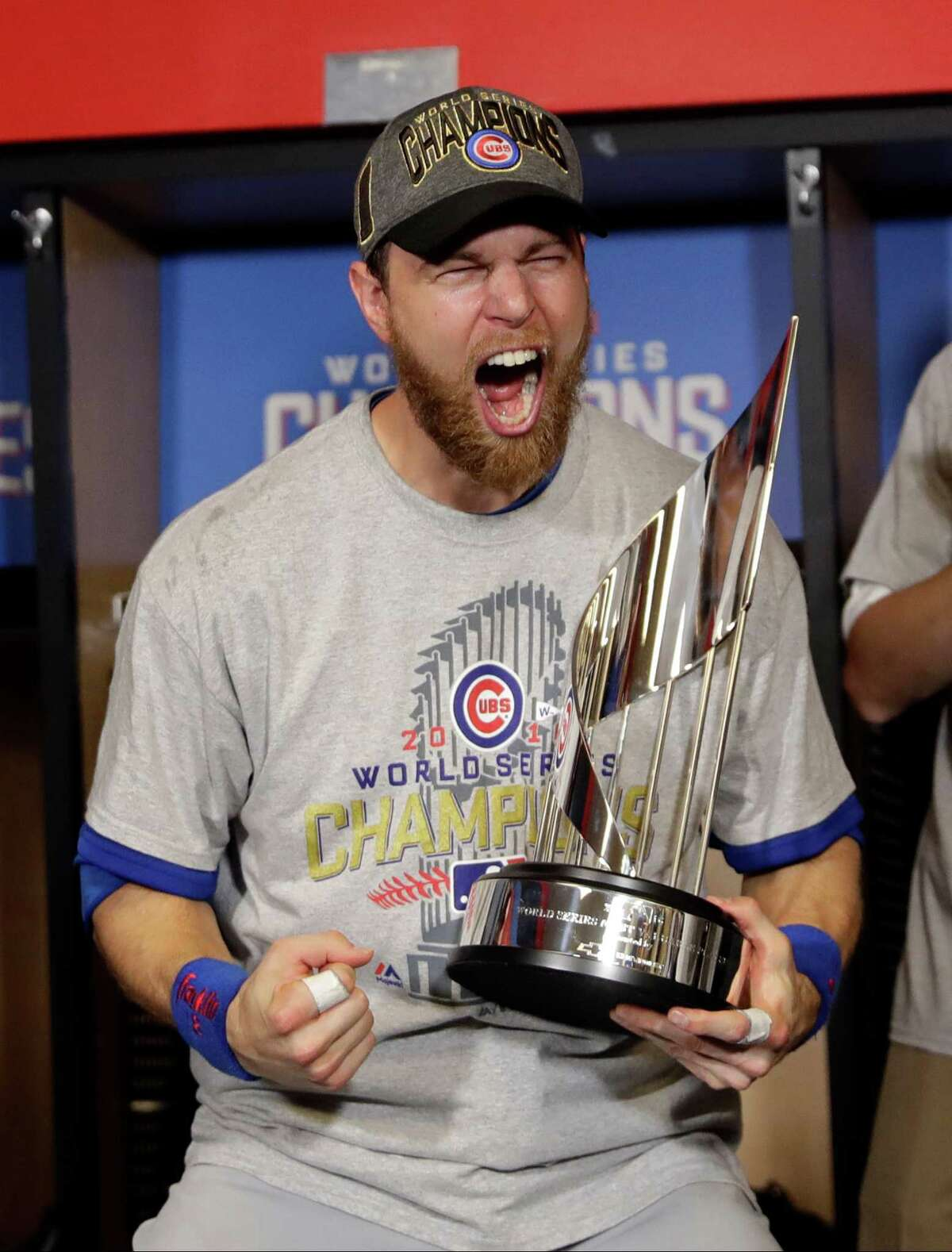 Chicago Cubs' Ben Zobrist celebrates with his MVP trophy after Game 7 of the Major League Baseball World Series against the Cleveland Indians Thursday, Nov. 3, 2016, in Cleveland. The Cubs won 8-7 in 10 innings to win the series 4-3. (AP Photo/David J. Phillip)