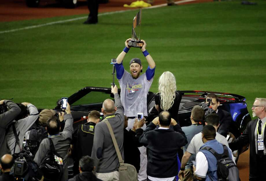 Chicago Cubs' Ben Zobrist celebrates with his MVP trophy after Game 7 of the Major League Baseball World Series against the Cleveland Indians Thursday, Nov. 3, 2016, in Cleveland. The Cubs won 8-7 in 10 innings to win the series 4-3. (AP Photo/Gene J. Puskar) Photo: Gene J. Puskar, Associated Press / Copyright 2016 The Associated Press. All rights reserved.