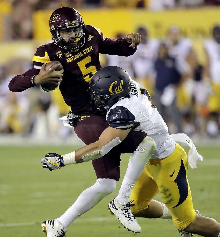 Cal junior linebacker Devante Downs sacks Arizona State quarterback Manny Wilkins on Sept. 24 in Tempe. Photo: Matt York, Associated Press