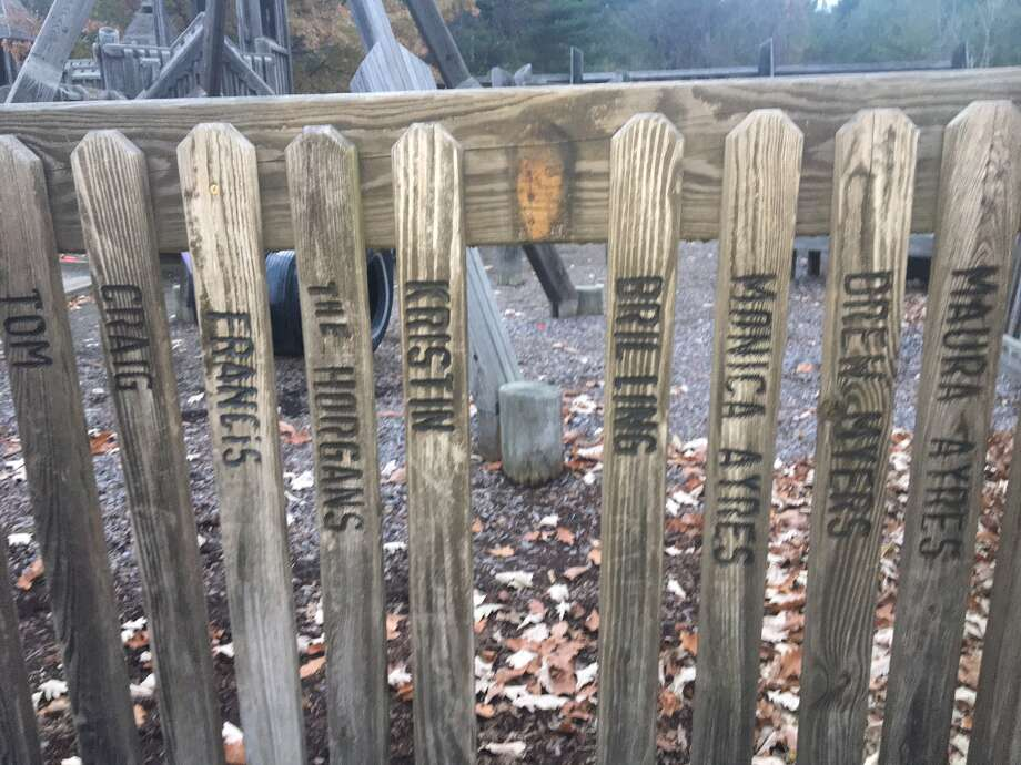 Volunteers who built the old wooden playground at Elm Avenue Park in Bethlehem had their names engraved on a picket fence. They are being alllowed to take those fence pieces home by the town this month.   Source: Larry Rulison