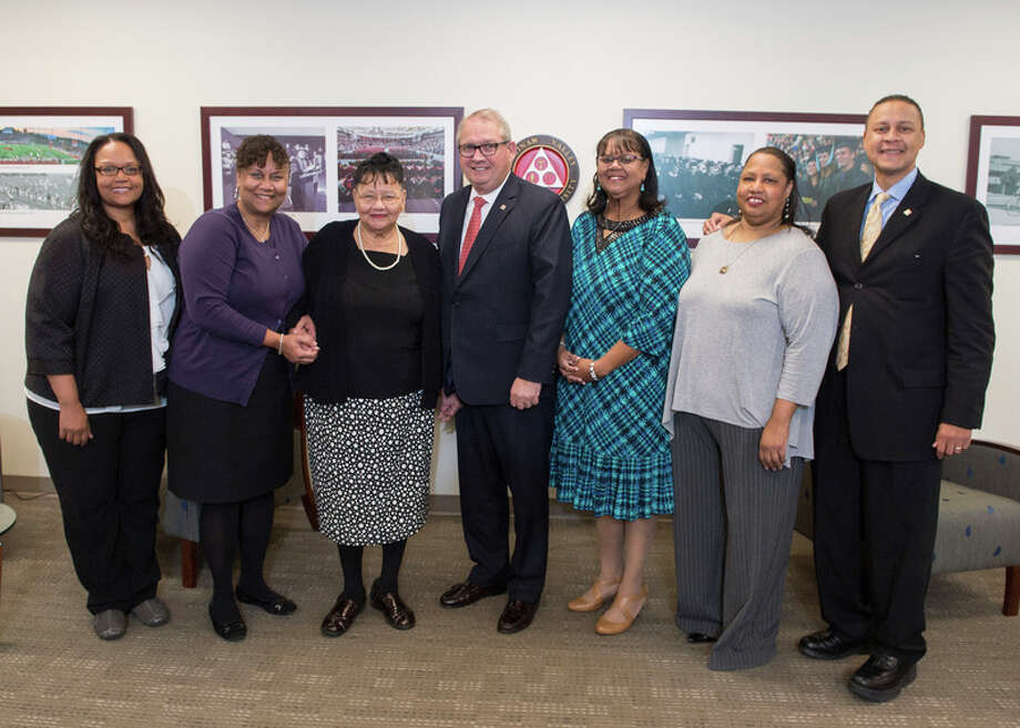 Photo provided by Tim Inman of SVSU Saginaw Valley State University President Donald Bachand (center) is joined by the family of Napoleon Lewis, Sr.: Shalynda Schrank, Alberta Lee, Nelia Lewis, Ava Lewis, Debra Lewis, and Dave Lewis.