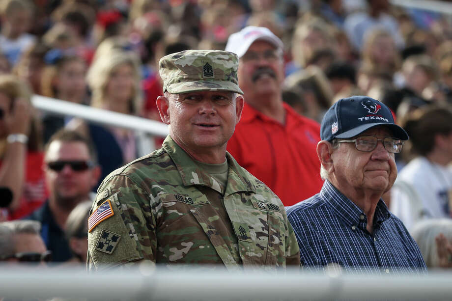 Veterans and service members stand as their military branch's songs are played during the Veterans Day Celebration on Tuesday, Nov. 1, 2016, at Bears Stadium in Montgomery. Photo: Michael Minasi, Staff / © 2016 Houston Chronicle
