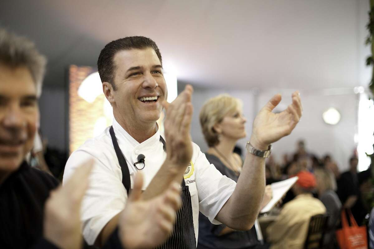Chef Michael Chiarello (middle) anticipate the auction sale of his Lot #10 at the Napa Valley Auction and the Napa Vintners' annual charity gala at Meadowood in St. Helena, California, on Saturday, June 4, 2011.
