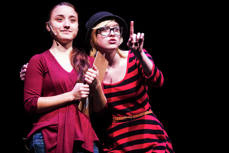 THEOPHIL SYSLO | For the Daily News Bullock Creek High School theatre students Nicole Mead, left, and Tamara Long, right, perform during a dress rehearsal of a production called Middletown at Bullock Creek High School on Wednesday.