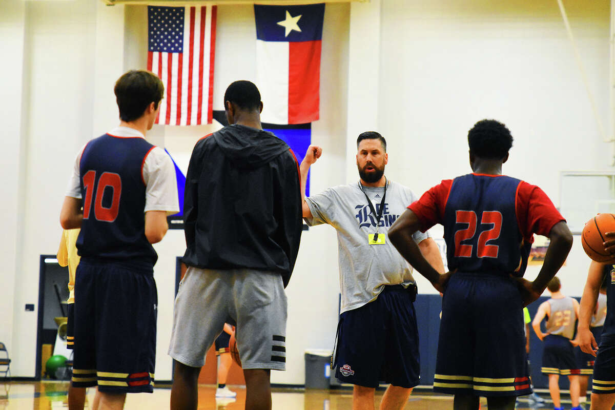 Klein Collins Basketball head coach Scott Harmatuk puts his players through the paces during athletic period earlier this week at Klein Collins High School. Harmatuk is blessed with a wealth of returning, veteran players and an influx of new talent, and believes his team will be competing against Klein Forest for the district title.
