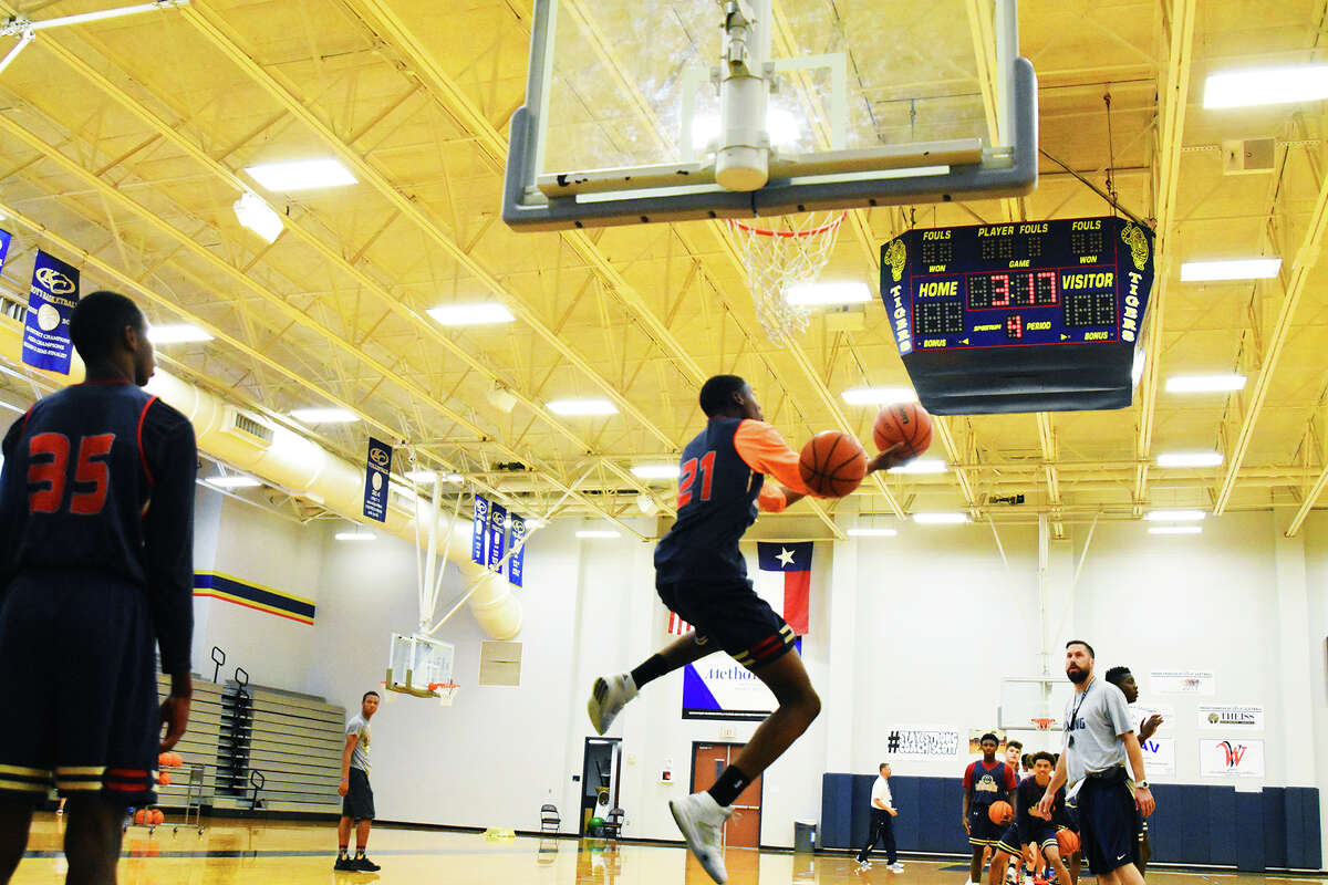 Klein Collins sophomore forward Montavious Murphy works on finishing around the rim at practice. Head coach Scott Harmatuk pointed to Murphy as a player he expects to take a major step forward this season, and a player that colleges are starting to key in on, given his blend of size and talent.