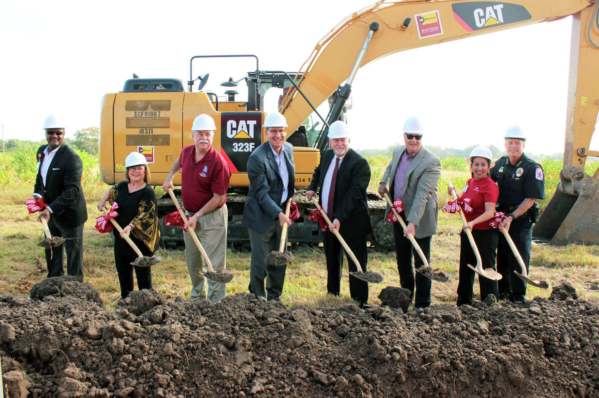Ground is broken for H-E-B's new Baytown store, Wednesday, Nov. 2, 2016. From left are James Harris, H-E-B director of diversity & inclusion and supplier diversity; Tracey Wheeler, president, Baytown Chamber of Commerce; Baytown City Council member Terry Sain; Scott McClelland, president, H-E-B Houston region; Baytown Mayor Stephen DonCarlos; city council member Robert Hoskins; Martha A. Barrera, H-E-B public affairs; Baytown Police Chief Keith Dougherty.