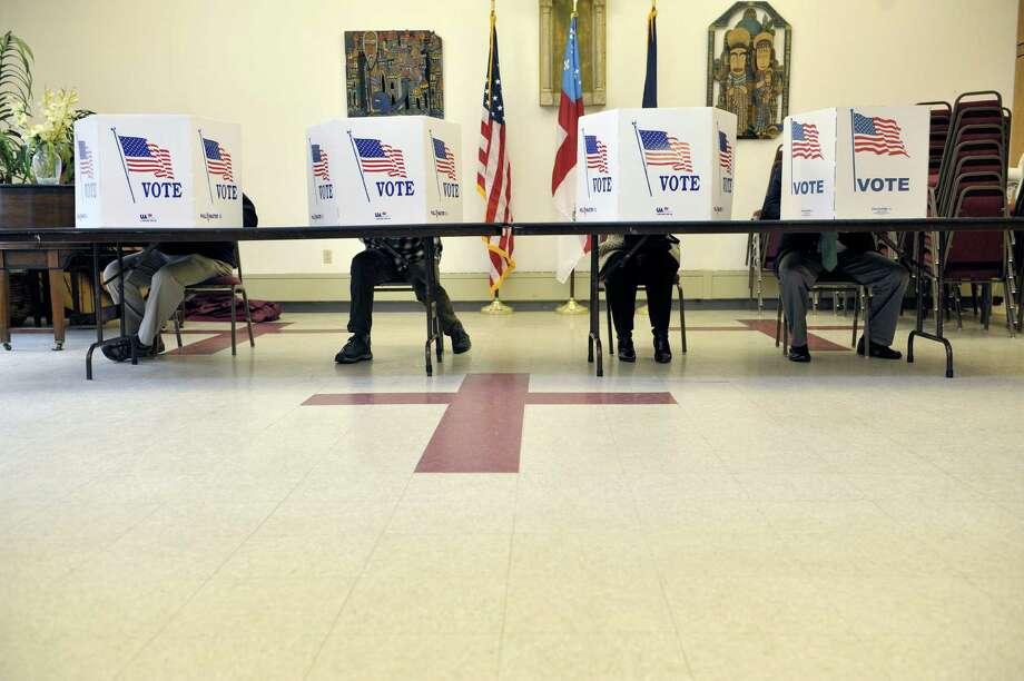 Voters cast their ballots at the polling station inside St. Paul's Episcopal Church on Tuesday, Nov. 4, 2014, in Kinderhook, N.Y.  (Paul Buckowski / Times Union) Photo: Paul Buckowski / 00029306A