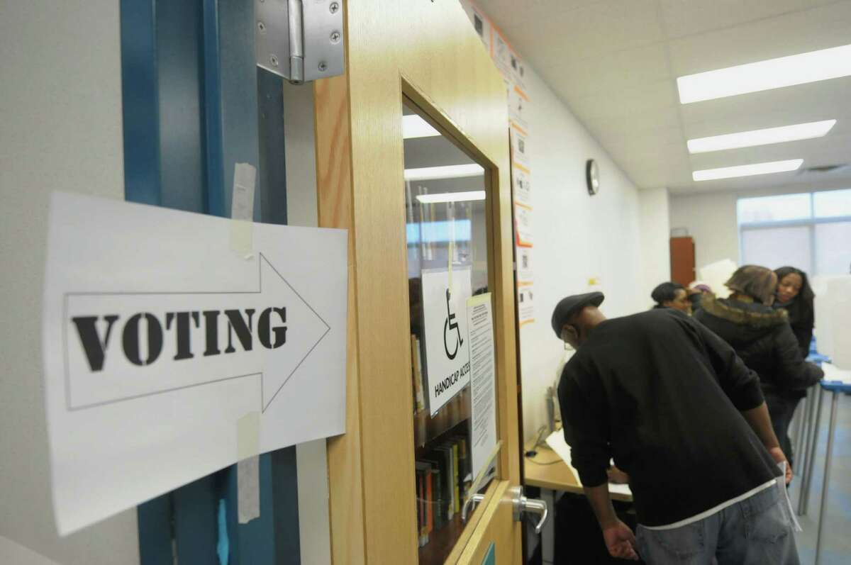 Voters fill out ballots at the polling station inside Green Tech High Charter School on Tuesday, Nov. 6, 2012 in Albany, NY. (Paul Buckowski / Times Union)