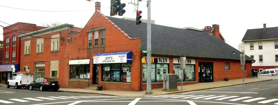 The commercial property at the corner of Center Street and Coram Avenue was sold in November 2016 for $410,000. The businesses will be displaced and structures demolished to make way for a mixed-use building. Photo: Contributed Photo