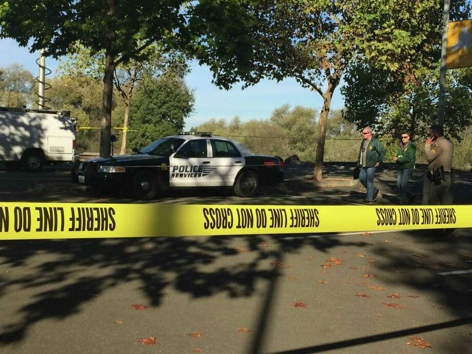 Sheriff's deputies block off parking lot at Sonoma State University Thursday morning, near where remains believed to be human were found in a shallow grave. Photo: Jenna Lyons / The Chronicle / Jenna Lyons / The Chronicle