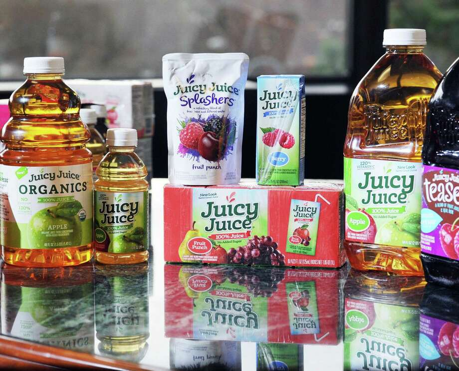 Products of the Harvest Hill Beverage Company that includes the Juicy Juice brand are seen on a table at Brynwood Partners, a private equity firm in Greenwich, Conn., Thursday, March 17, 2016. The Juicy Juice brand is one of the products of the Harvest Hill Beverage Company, one of the companies belonging to Brynwood Partners. Photo: Bob Luckey Jr. / Hearst Connecticut Media / Greenwich Time