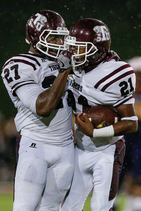 Texas Southern Tigers linebacker Jamal Lucas (27) congratulates Texas Southern Tigers defensive back Demetrius Johnson (21) on an interception as the Prairie View Am Panthers take on the Texas Southern Tigers at Panther Stadium at Blackshear Field Sunday, September 4, 2016 in Prairie View. ( Michael Ciaglo / Houston Chronicle ) Photo: Michael Ciaglo, Staff / © 2016  Houston Chronicle