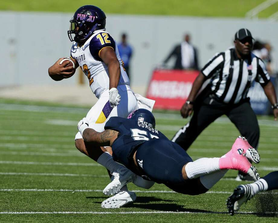 HOUSTON, TX - OCTOBER 22:  Jalen Morton #12 of the Prairie View Am Panthers is brought down by Preston Gordon #57 of the Rice Owls at Rice Stadium on October 22, 2016 in Houston, Texas.  (Photo by Bob Levey/Getty Images) Photo: Bob Levey, Stringer / 2016 Getty Images