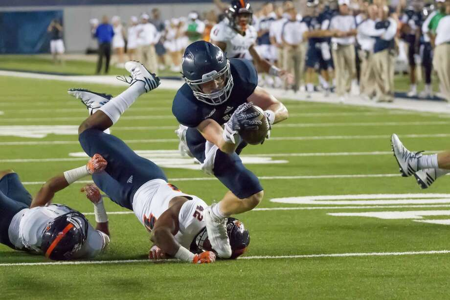 October 15 2016:  Rice Owls tight end Connor Cella (87) gets the ball to within a yard of the end zone during the NCAA football game between the UTSA Roadrunners and Rice Owls in Houston, Texas.  (Leslie Plaza Johnson/Chronicle) Photo: Leslie Plaza Johnson, Freelancer / Freelance