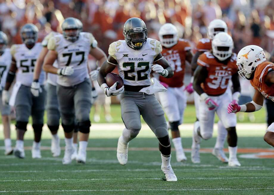 Baylor running back Terence Williams (22) runs against Texas  during the second half on a NCAA college football game, Saturday, Oct. 29, 2016, in Austin, Texas. Texas won 35-34. (AP Photo/Eric Gay) Photo: Eric Gay, STF / AP