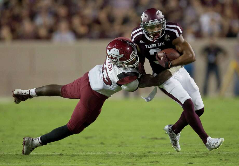 Texas A&M's Christian Kirk (3) fights off a tackle attempt by New Mexico State's Rodney Butler (53) during the first quarter of an NCAA college football game Saturday, Oct. 29, 2016, in College Station, Texas. Texas A&M won 52-10. (AP Photo/Sam Craft) Photo: Sam Craft, FRE / AP