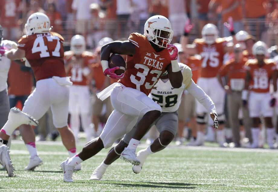 Texas running back D'Onta Foreman (33) runs for a 37- yard touchdown against Baylor during the first half on a NCAA college football game, Saturday, Oct. 29, 2016, in Austin, Texas. (AP Photo/Eric Gay) Photo: Eric Gay, STF / Copyright 2016 The Associated Press. All rights reserved.