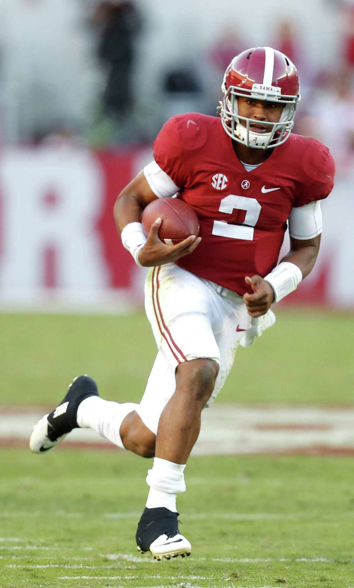 Alabama Crimson Tide quarterback Jalen Hurts (2) on his 27-yard run for a touchdown as during the fourth quarter of a college football game at Bryant-Denny Stadium, Saturday,Oct. 22, 2016 in Tuscaloosa. ( Karen Warren / Houston Chronicle )