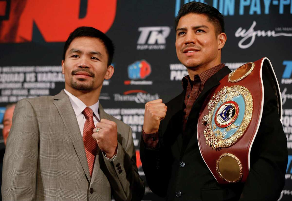 Manny Pacquiao, left, and Jessie Vargas pose during a news conference in Beverly Hills, Calif., on Thursday, Sept. 8, 2016, about their WBO welterweight title fight scheduled for Nov. 5. (AP Photo/Damian Dovarganes)